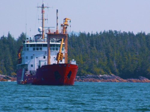 Canadian Coast Guard Vessel 'Bartlett' delivering supplies to the Ivory Island light station. Note the whaler, or tender, alongside.
