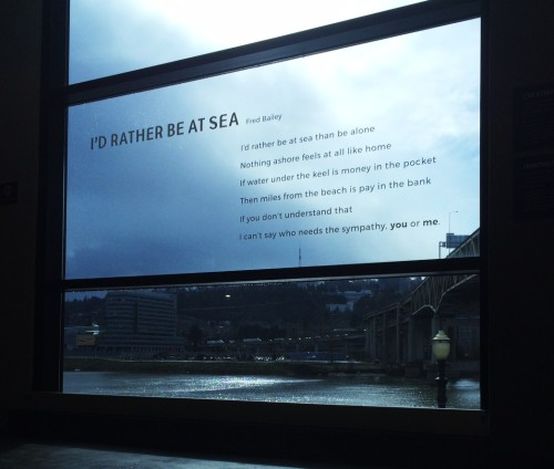 A poem of mine in a window of the Oregon Museum of Science And Industry looking out on the Willamette River. Photo courtesy of Cecilia Nguyen OMSI