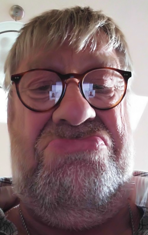 Just for a laugh. A geezer discovers selfies. Captions: -Wot 'appens if I push this? - Nowt worse than a dog fart! - A face even a mother can't love -Ever been to sea Billy?