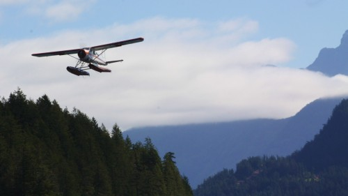 A DeHavilland Beaver, famous workhorse of the BC coast. It negotiates the rapids in a minute and has the passengers in town before I am out of sight of the rapids.