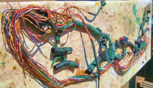 The Autopsy. Part of a Volvo Diesel engine wiring harness after an electrical fire. Each engine has three computers to the utter despair of this old fart.