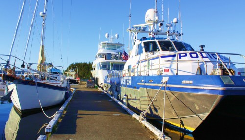 Boats of a feather seldom flock together. 'Serengeti' and tender in background, RCMP patrol catamaran 'Inkster' on right, and that's me in the corner. 'Seafire'  with a whale bone on her sprit above Happy Harry Heiltsuk.