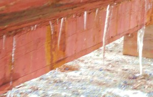 Finding The Leaks Each icicle marks a flaw in the tired old caulking which won't hold rain water in.