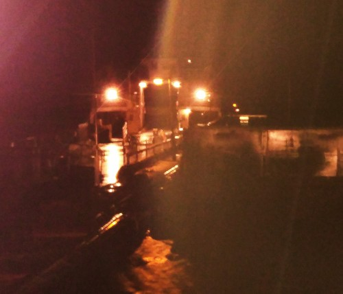 Night Moves Midnight, pouring rain ink darkness, I wait at the ferry dock, the only passenger.