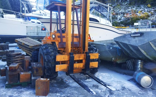 Beep, beep , beep, bee...Shit! The reverse runaway forklift. Thank goodness for the ice. The expensive boat behind the forklift was spared by one inch.