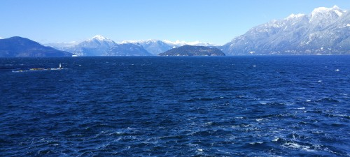 Outflow Wind. Looking up Howe Sound from the deck of a ferry in Horseshoe Bay. Outflow winds from the snowfields and glaciers beyond Whistler accelerate down the Sound and head out to sea. It is bloody cold!